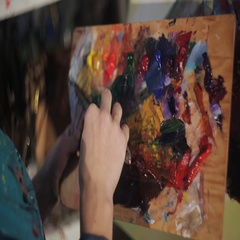 Girl artist paints with oil painting Stock Footage