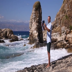 Happy Man Doing Vacation Filming Mobile Phone Seascape Huge Waves Sea Coast Day Stock Footage