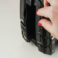 Woman Plugging a Yellow Cable to a Video Camera Stock Footage