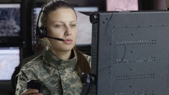 Female drone operator talking with headset Stock Footage
