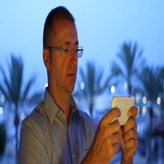 Tourist American Man Send Message Mobile Phone Team Work Technology Palm Trees Stock Footage