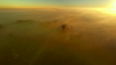 Surreal Autumn flight over foggy landscape of fields and farms Stock Footage