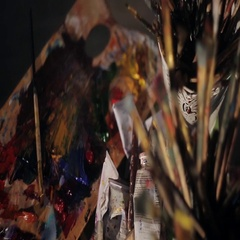 Many brushes, stained in oil paints. Art studio Stock Footage