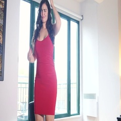 Sexy dancing plus size girl in red dress Stock Footage
