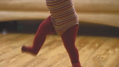 Baby's legs ,walking inthe room Stock Footage