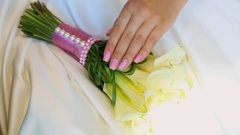 Close up of bride hands with professional bridal pink and white manicure Stock Footage