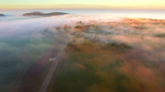 Surreal Autumn flight over foggy landscape at sunrise Stock Footage
