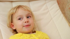 Cute girl laughing in the rocking chair Stock Footage