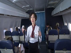 Female flight attendant demonstrates seat belt to airline passengers 4K Stock Footage