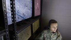 Female military drone operator, wide shot Stock Footage