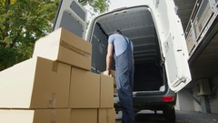 Young Loader Puts Boxes Into His Commercial Vehicle. Stock Footage
