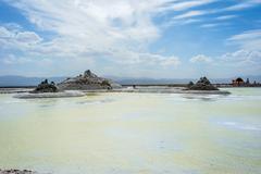 Chaqia (Chakayan) salt lake and salt mine with sun umbrellas.  Stock Photos