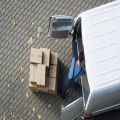 Delivery Man Loads his Commercial Van with Cardboard Boxes. Speed up Video. Stock Footage