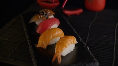 Hand with red chopsticks taking sushi Stock Footage