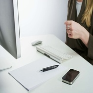 Woman Turning the Monitor On and Typing Stock Footage
