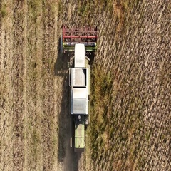 Drone shot of agricultural machinery moving in field Stock Footage