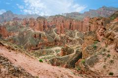 Walking paths around sandstone rock formation at Zhangye Danxia National Geologi Stock Photos