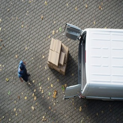 Delivery Man Loads his Commercial Van with Cardboard Boxes. Stock Footage