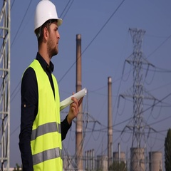 Young Electrician Man Holding Examine Power Plant Plan Scheme Looking Analyzing Stock Footage