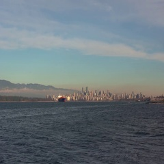 Wide shot of Vancouver cityscape, the North Shore Mountains and English Bay Stock Footage