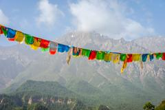 Buddhist praying flags against the mountain landscape, by Mati Si Temple, Gansu, Stock Photos
