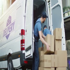 Two Strong Delivery Men Loading Commercial Vehicle Full of Cardboard Boxes. Stock Footage