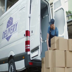 Young Mover Loads his Commercial Vehicle with Large Cardboard Boxes.  Stock Footage