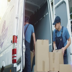 Two Strong Delivery Men Quickly Loading Commercial Vehicle Full of Cardboard Box Stock Footage