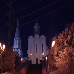 The Church and the alley with snow-covered trees dark night. Stock Footage