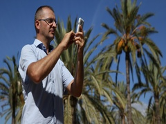 Man Use Mobile Phone Internet Surfing Exotic Vacation Travel Concept Palm Trees Stock Footage