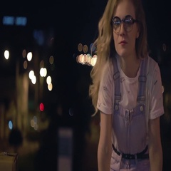 Girl walking at the night city with bokeh light background and have a fun Stock Footage