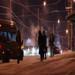 People at a bus stop on a winter evening. Stock Footage