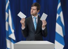 Election in Greece. Undecided voter is making decision. Stock Photos