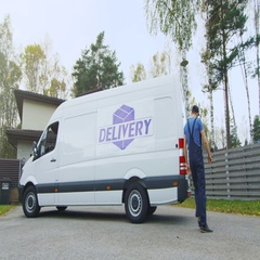 Delivery Man Takes Cardboard Boxes Out of His Cargo Van. In a Suburban Area. Sun Stock Footage