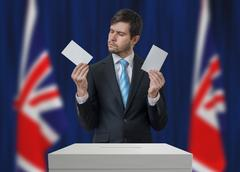 Election in United Kingdom. Undecided voter is making decision. Stock Photos