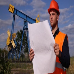 Young Engineer Man Reading Pumpjack Blueprint Looking Oil Pump Project Planning Stock Footage
