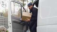 Joyfull Delivery Man Comes Out of His Cargo Van and Goes Towards Camera. Stock Footage