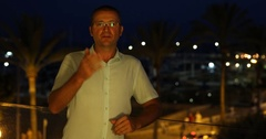 Tourist Man Talking Looking Camera Vacation Palms Trees Nightlife Exotic Travel Stock Footage
