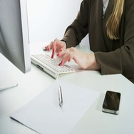 Woman Typing on a Keyboard Stock Footage