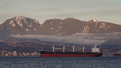 Timelapse of a container ship in English Bay set against the Mountains at dusk Stock Footage