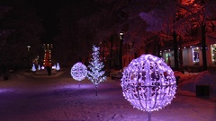 Festive Christmas illuminations in the night city, the snow falls. Stock Footage
