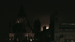 Super Moon rising behind the Library of Parliament in Ottawa Stock Footage