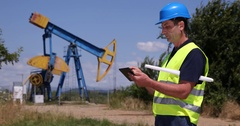 Pumpjack Technician Man Working Digital Tablet Checking Report Oil Pump Farm Job Stock Footage