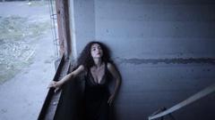 Beautiful girl near an old wall Stock Footage
