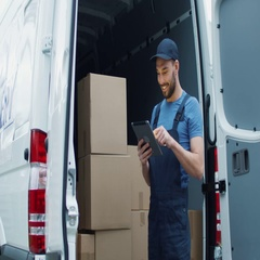Smiling Delivery Man with a Tablet Checks His Cargo Count. Stock Footage