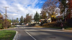 Traffic small town autumn, narrow road, nice light Stock Footage