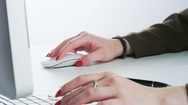 Woman Using Mouse, Typing and Taking a Ballpen Stock Footage