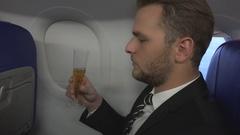 Business Man Drink Sparkling Wine Celebration Corporate Airplane Flight Travel Stock Footage