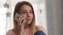 Young girl taking by phone and hear a bad news, emotions Stock Footage