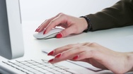 Woman Using Mouse, Typing and Drawing on a Paper Stock Footage